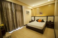 Santonis Place 1BR Bedroom 1